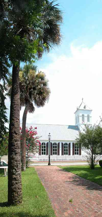 Pensacola:-Historic-Pensacola-Village:-Old-Christ-Church_06.jpg:  plaque, historic marker, brick structure, religious service, church house, crepe myrtle trees, palm trees, victorian village