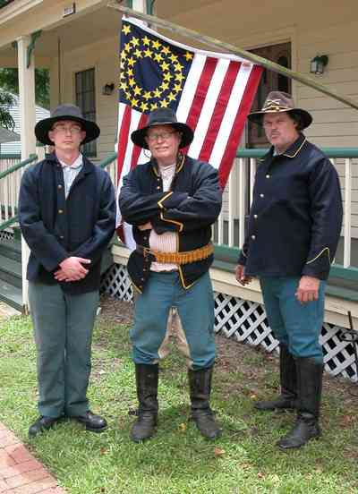 Pensacola:-Historic-Pensacola-Village:-The-Weavers-Cottage_01aa.jpg:  colonial village, historical reenactment, civil war soldiers, brick sidewalk, colonial cottage, gulf coast cottage