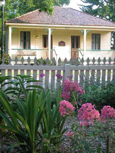 Pensacola:-Historic-Pensacola-Village:-The-Weavers-Cottage_01b.jpg:  victorian cottage, front porch, shake roof, wood shingle roof, gulf coast cottage, pyramidal roof, pecan trees,