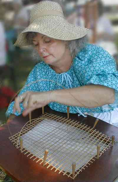 Pensacola:-Historic-Pensacola-Village:-The-Weavers-Cottage_07.jpg:  weaver, reenactor, quilting, caning, bonnet, historic reenactment