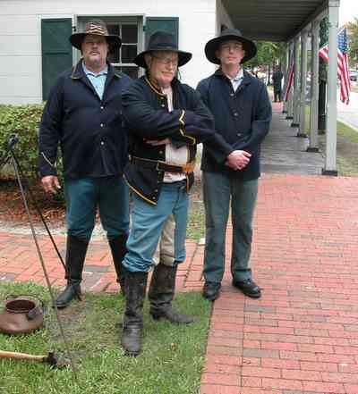 Pensacola:-Historic-Pensacola-Village:-Tivioli-House_00b.jpg:  historical reenactment, civic war soldiers, brick sidewalk, encampment, demonstration