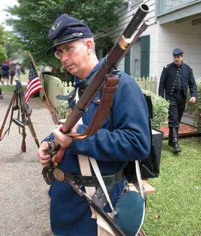 Pensacola:-Historic-Pensacola-Village:-Tivioli-House_01dd.jpg:  civil war soldier, encampment, battle, rifle, american flag, historic village, colonial village
