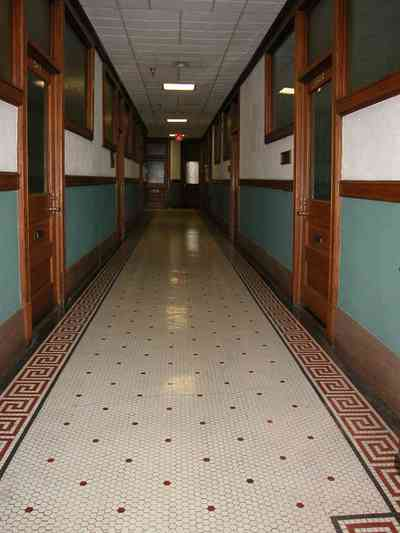 Pensacola:-Palafox-Historic-District:-Blount-Building_06.jpg:  marble floor, casement window, terrazzo tile floor, wainscotting