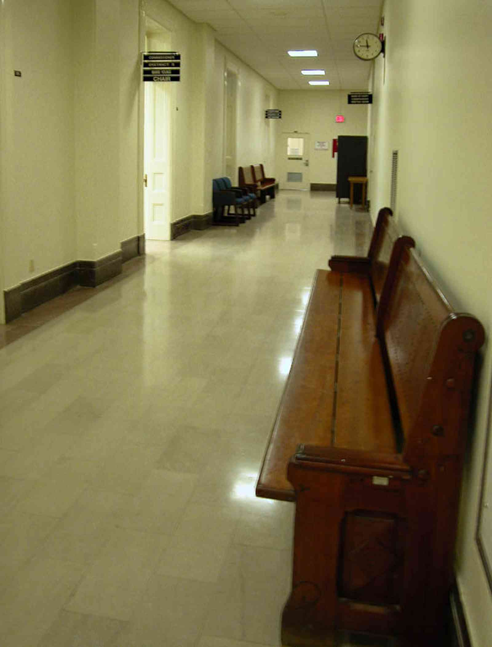 Pensacola:-Palafox-Historic-District:-Escambia-County-Courthouse_08.jpg:  marble floor, marble walls, oak table, foyer, entrance, courthouse, oak bench, county commissioners, public building