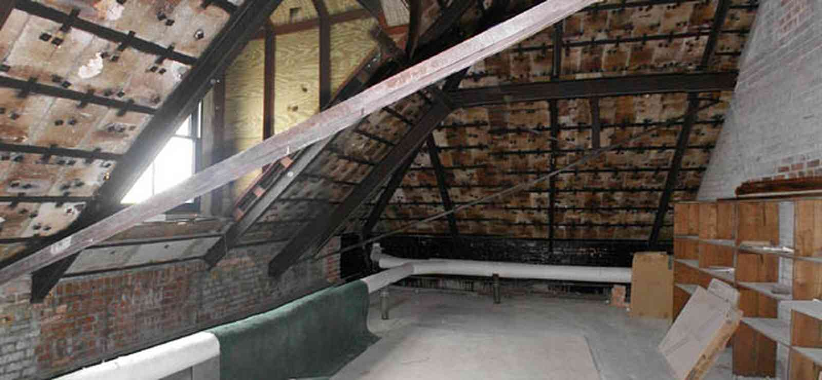 Pensacola:-Palafox-Historic-District:-Escambia-County-Courthouse_14.jpg:  attic, roof tiles, metal spring tension braces, brick walls