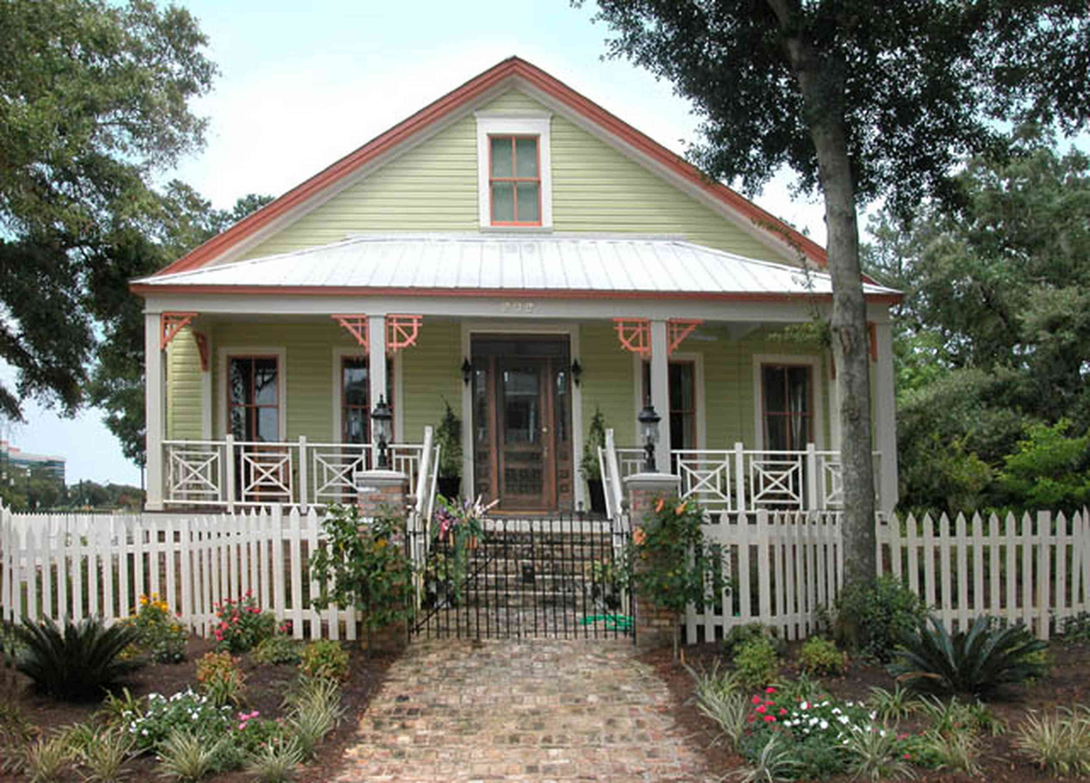 Pensacola:-Seville-Historic-District:-202-Cevallos-Street_01.jpg:  picket fence, brick sidewalk, oak tree, palm tree, front porch, 4 square georgian style