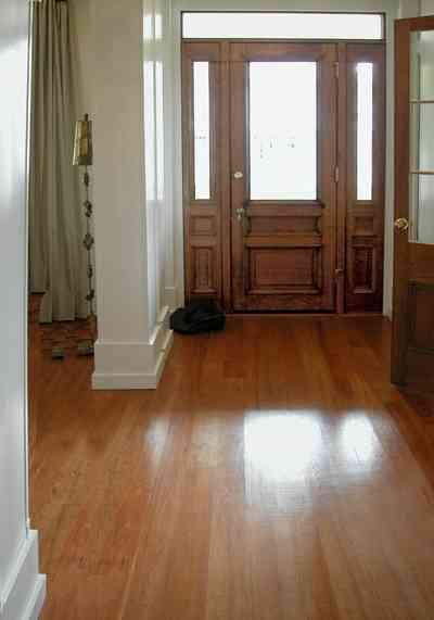 Pensacola:-Seville-Historic-District:-202-Cevallos-Street_05.jpg:  heart pine floors, front door, side lights, transom, front hall, living room