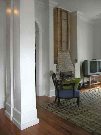 Pensacola:-Seville-Historic-District:-202-Cevallos-Street_09a.jpg:  heart pine floors, fireplace, central hall, living room
