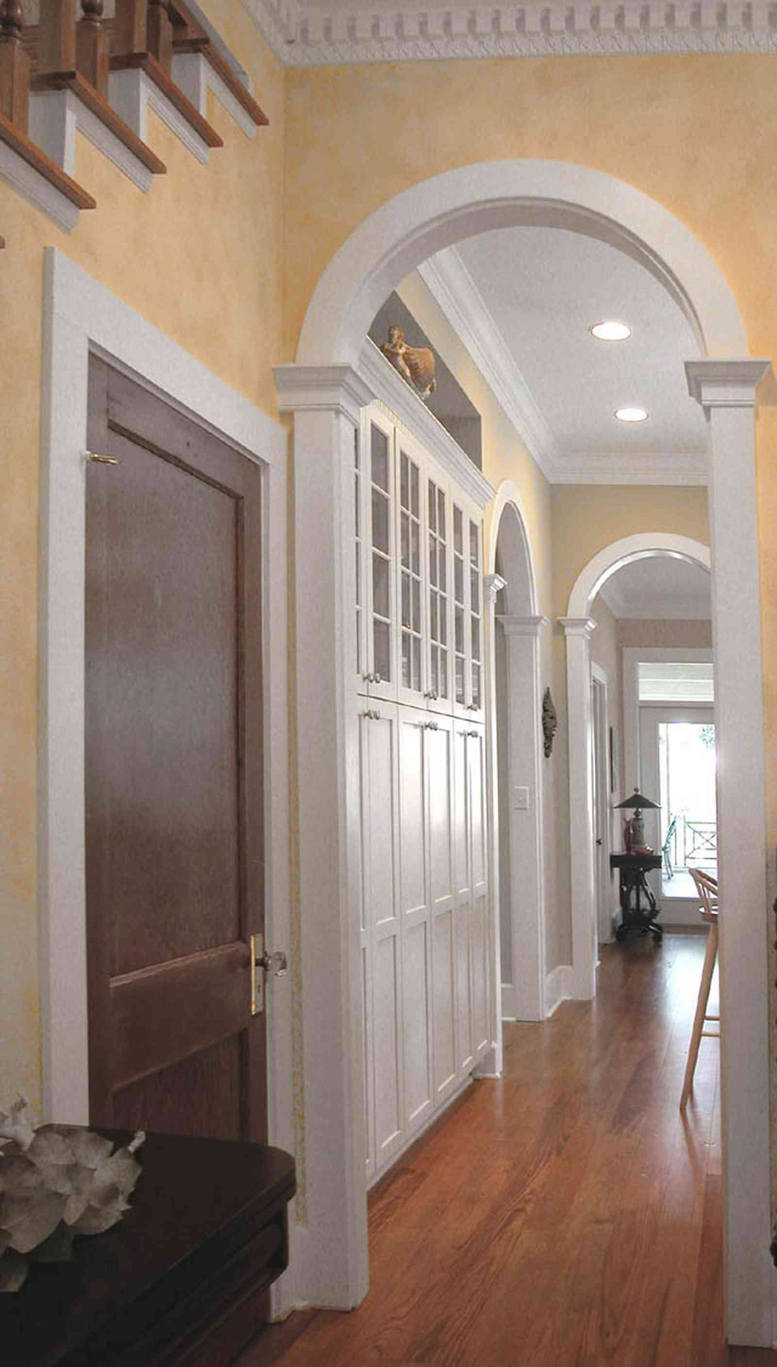 Pensacola:-Seville-Historic-District:-202-Cevallos-Street_12.jpg:  kitchen, cabinets, arched doorway, columns, victorian cottage, heart pine floors,