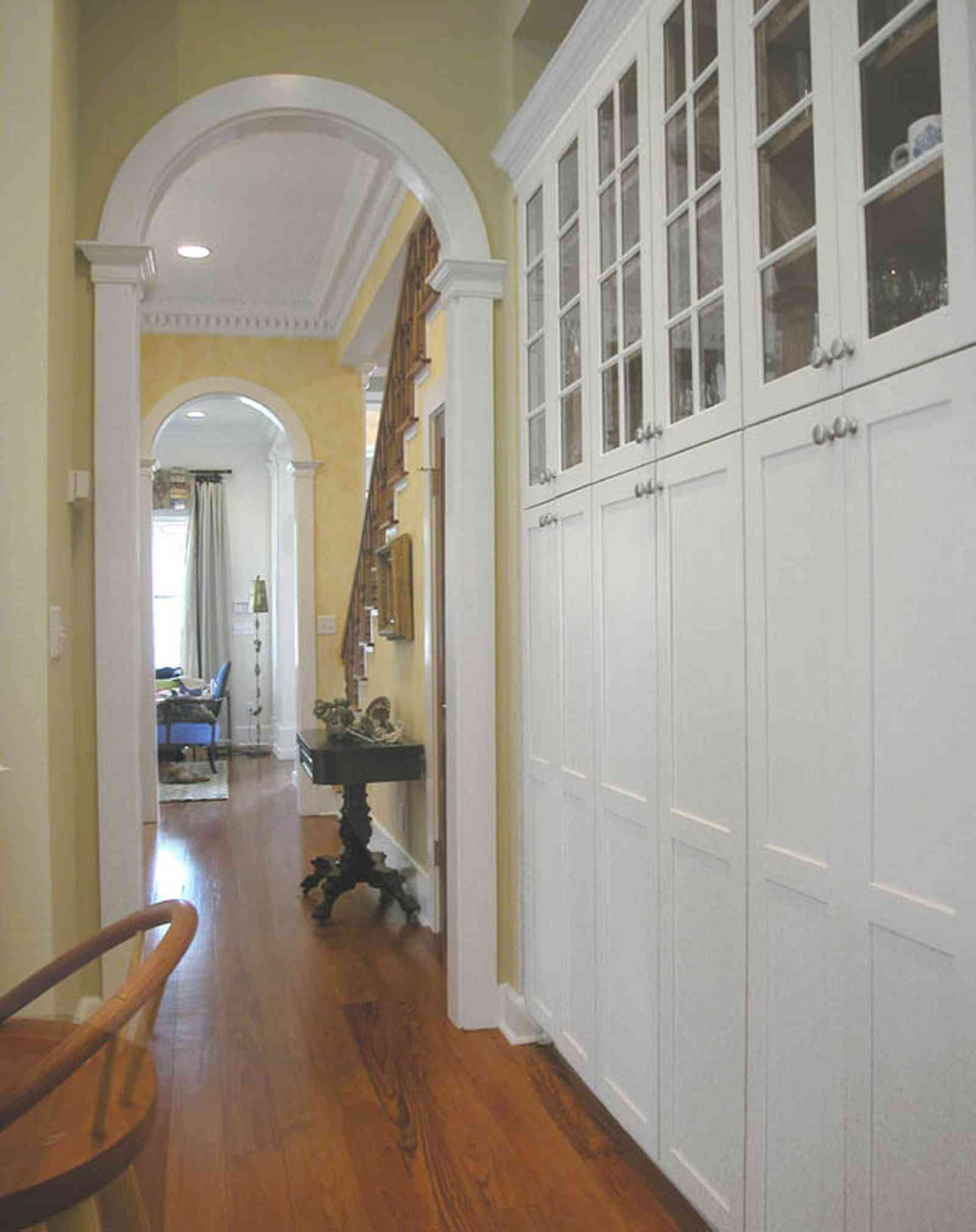 Pensacola:-Seville-Historic-District:-202-Cevallos-Street_13.jpg:  cabinets, heart pine floors, staircase, dining room, kitchen, columns, arcade, arched doorway
