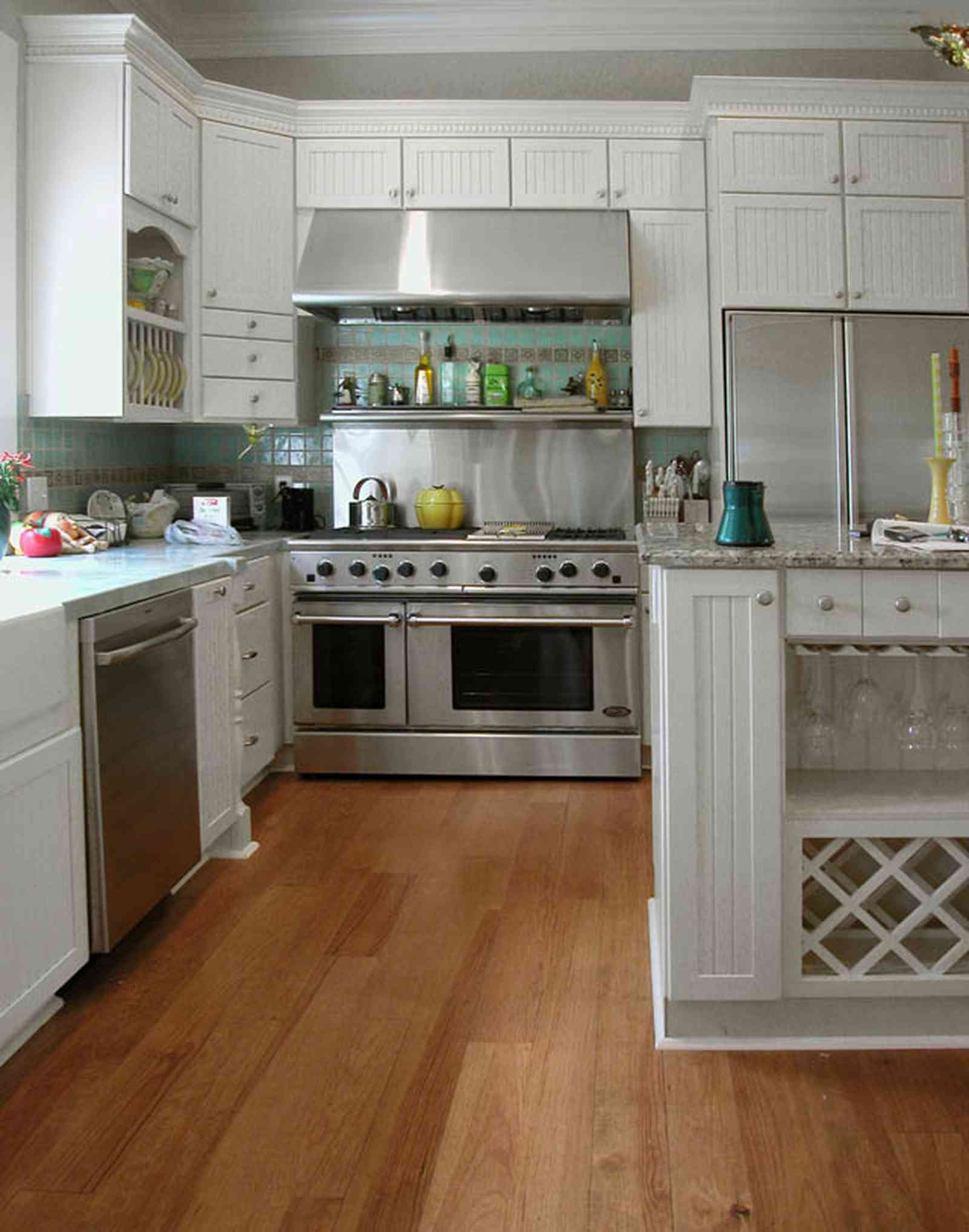 Pensacola:-Seville-Historic-District:-202-Cevallos-Street_17.jpg:  wine rack, heart pine floors, stainless steel stove, oven, range, kitchen cabines, green tile, victorian cottage