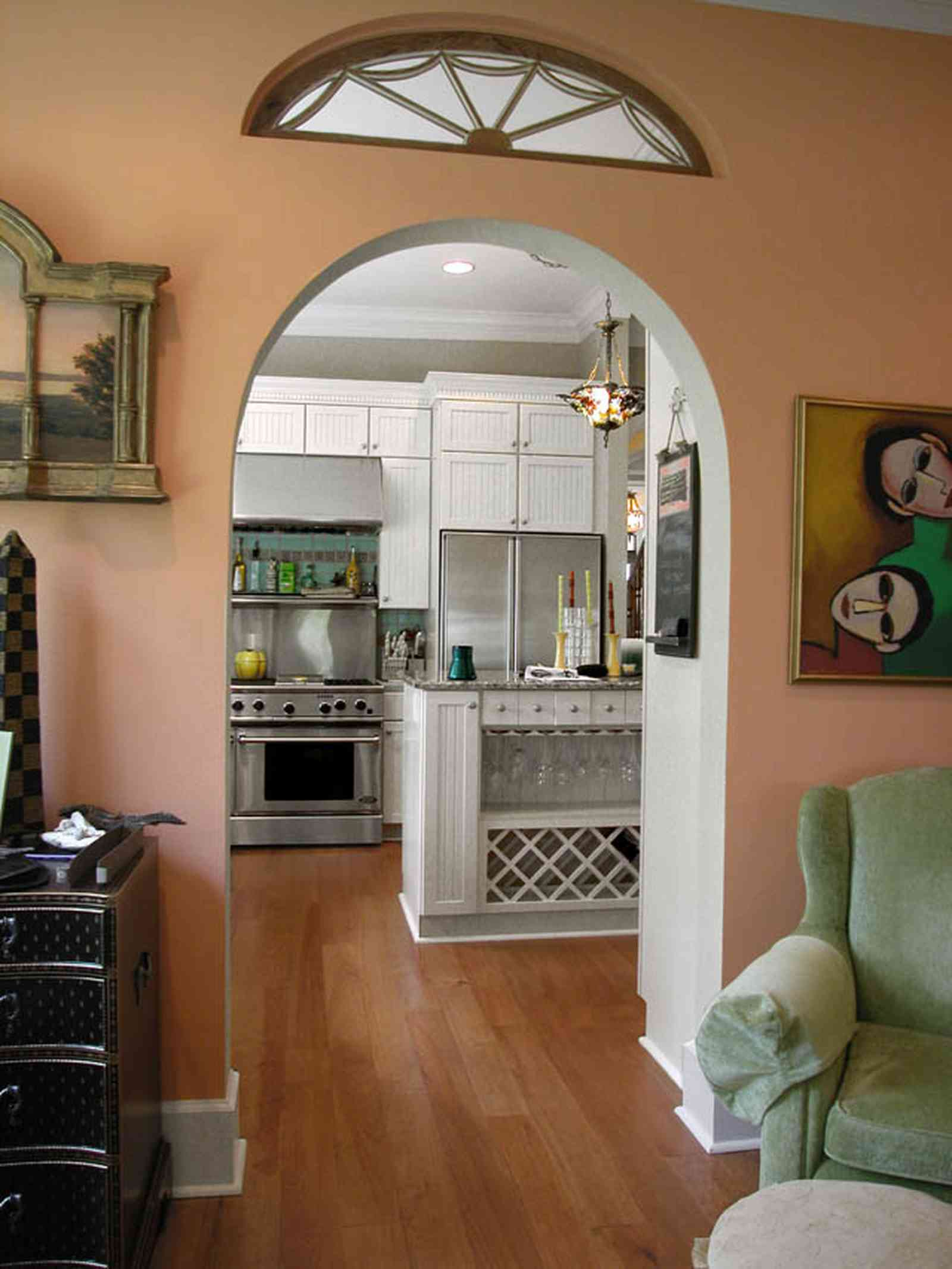 Pensacola:-Seville-Historic-District:-202-Cevallos-Street_19.jpg:  fanlight, heart pine floors, wine rack, kitchen cabinet, arched doorway, den, family room, stainless steel appliances