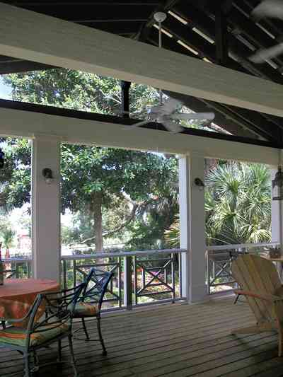 Pensacola:-Seville-Historic-District:-202-Cevallos-Street_25.jpg:  back porch, wooden deck, palm trees, patio, deck, screened porch, victorian cottage