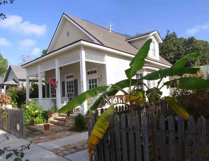 Pensacola:-Seville-Historic-District:-212-South-Florida-Blanca-Street_01.jpg:  victorian house, victorian front porch, historic district, banana tree, picket fence, gingerbread trim