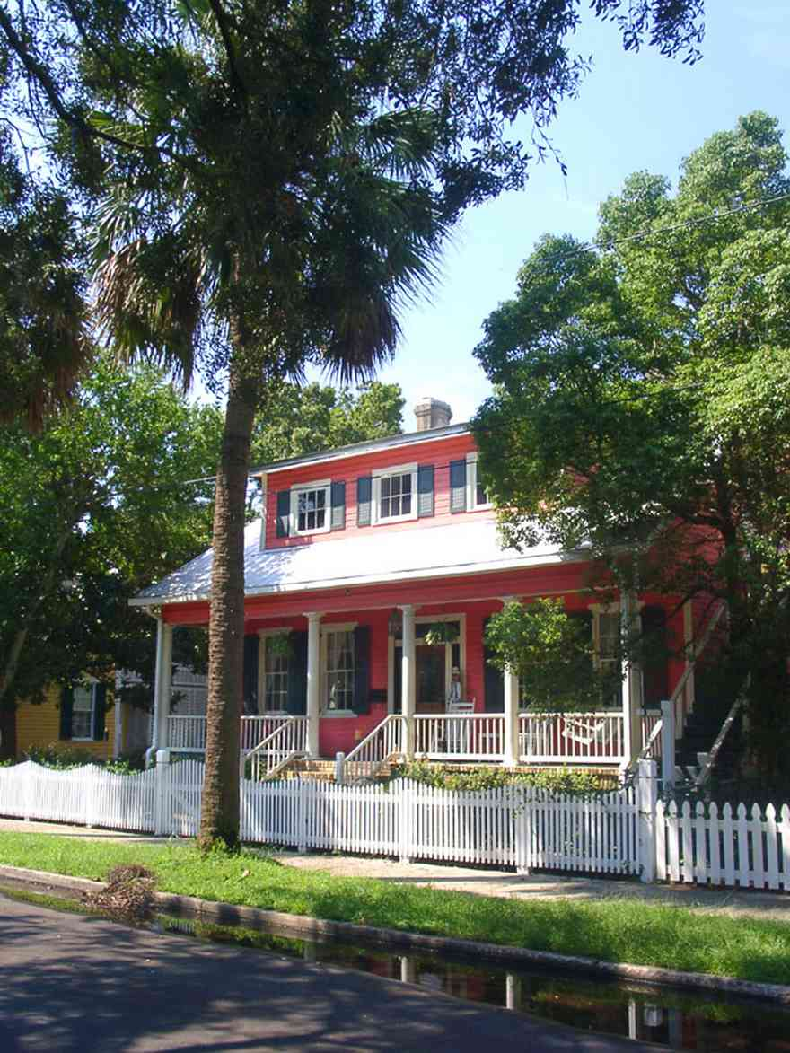 Pensacola:-Seville-Historic-District:-305-South-Adams-Street_00.jpg:  4-square georgian architectural style, victorian cottage, palm trees, picket fence, victorian porch, seville square