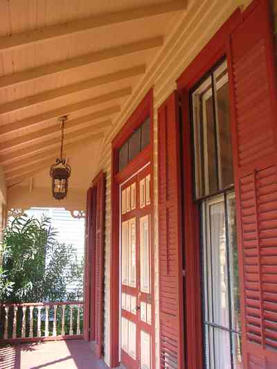 Pensacola:-Seville-Historic-District:-412-East-Government-Street_04.jpg:  victorian house, victorian front porch, balustrade, lantern, shutters, gingerbread trim