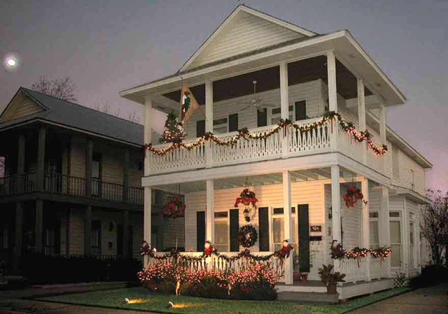 Pensacola:-Seville-Historic-District:-426-East-Intendencia-Street_01a.jpg:  garland, bows, poinsetta baskets, twinkling lights swags, shutters, front porch, victorian shotgun house, two-story house