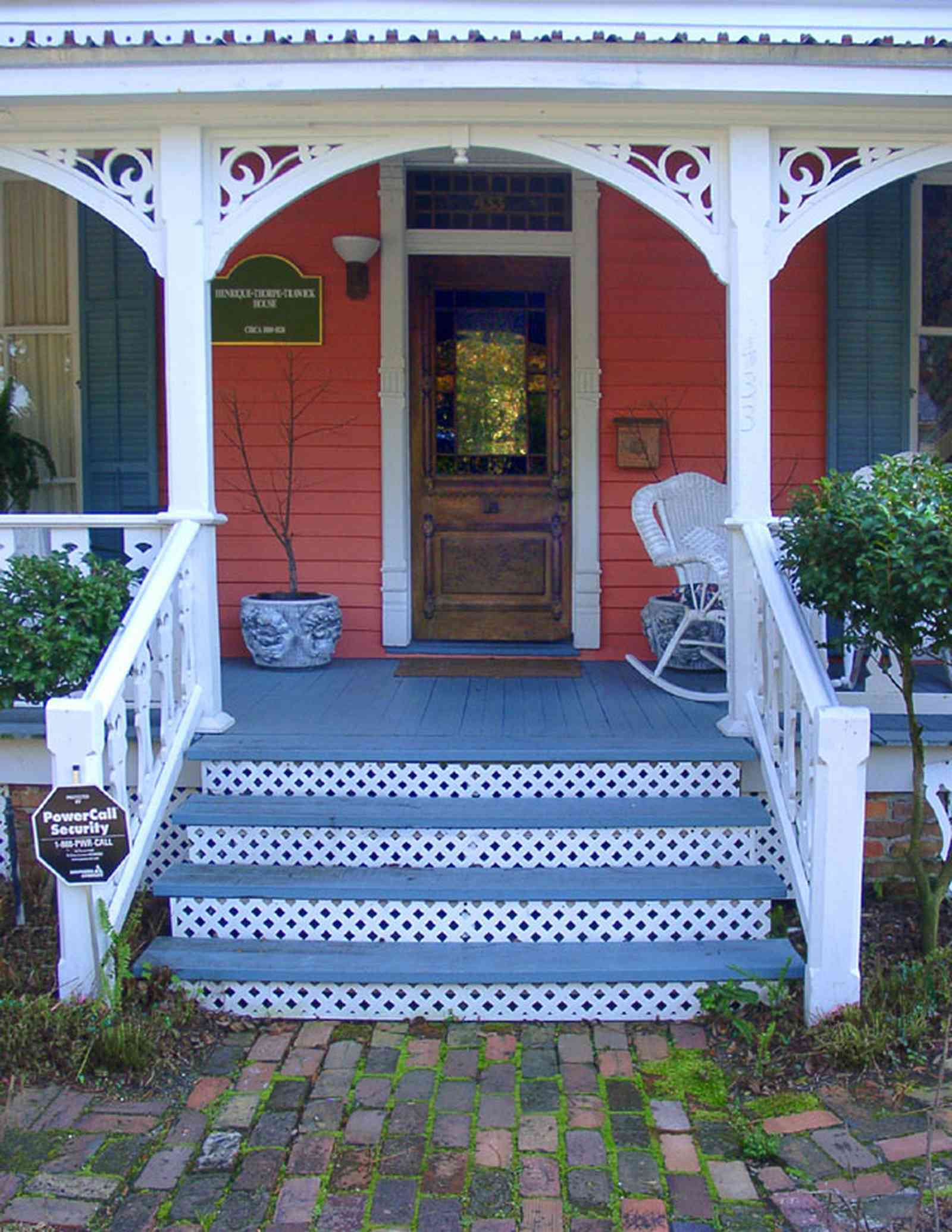Pensacola:-Seville-Historic-District:-433-East-Zaragoza-Street_01.jpg:  victorian house, victorian front porch, wicker rocking chair, leaded stained glass, brick sidewalk