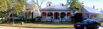 Pensacola:-Seville-Historic-District:-433-East-Zaragoza-Street_02.jpg:  pyramidal roof, four-square georgian architectural style, victorian house, victorian front porch, historic village