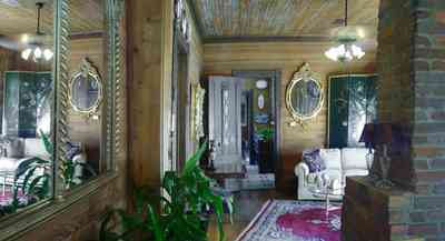 Pensacola:-Seville-Historic-District:-433-East-Zaragoza-Street_32a.jpg:  mirrors, oriental rug, fireplace, wainscotting