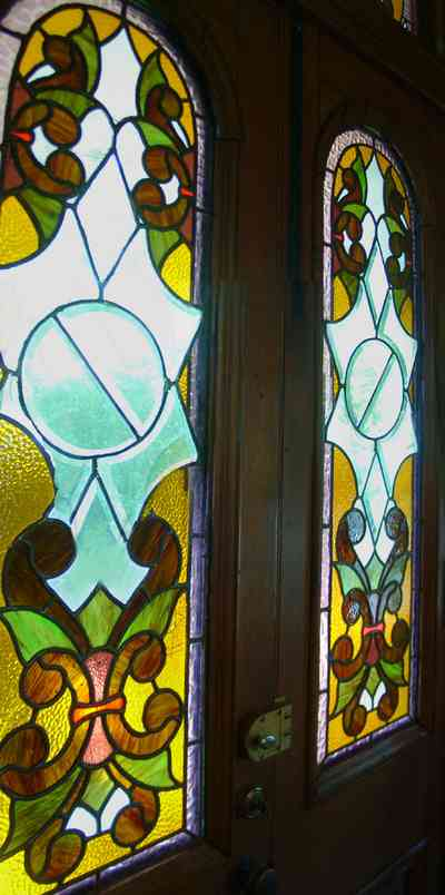 Pensacola:-Seville-Historic-District:-433-East-Zaragoza-Street_41.jpg:  victorian house, stained glass door