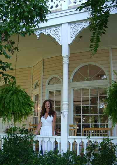 Pensacola:-Seville-Historic-District:-BW-Properties_01.jpg:  victorian front porch, bannister, folk victorian, gingerbread trim