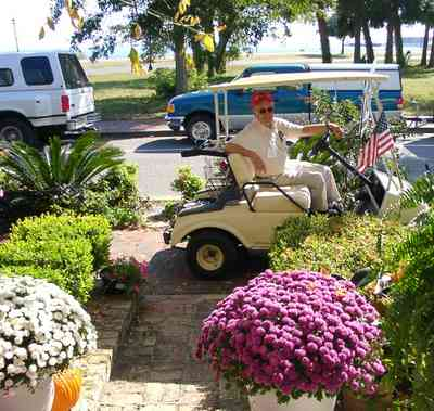 Pensacola:-Seville-Historic-District:-BW-Properties_30.jpg:  golf cart, bob quigley, chrysanthamum. escambia bay, bayfront parkway