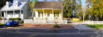 Pensacola:-Seville-Historic-District:-Chloe-And-Sophies-Attic_03.jpg:  victorian house, antique shop, white picket fence, pecan trees, four-square georgian house, shutters,