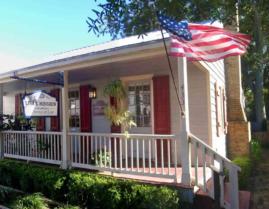 Pensacola:-Seville-Historic-District:-Lisa-Minshew-Attorney_00.jpg:  creole cottage, american flag, historic district, law office, columns, porch, wooden