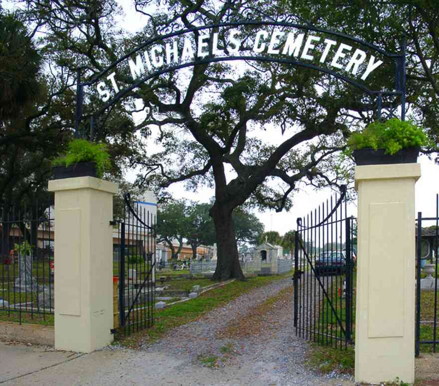 Pensacola:-Seville-Historic-District:-St-Michael-Cemetery_01.jpg:  cemetery, gate, wrought iron gate, oak tree, ferns