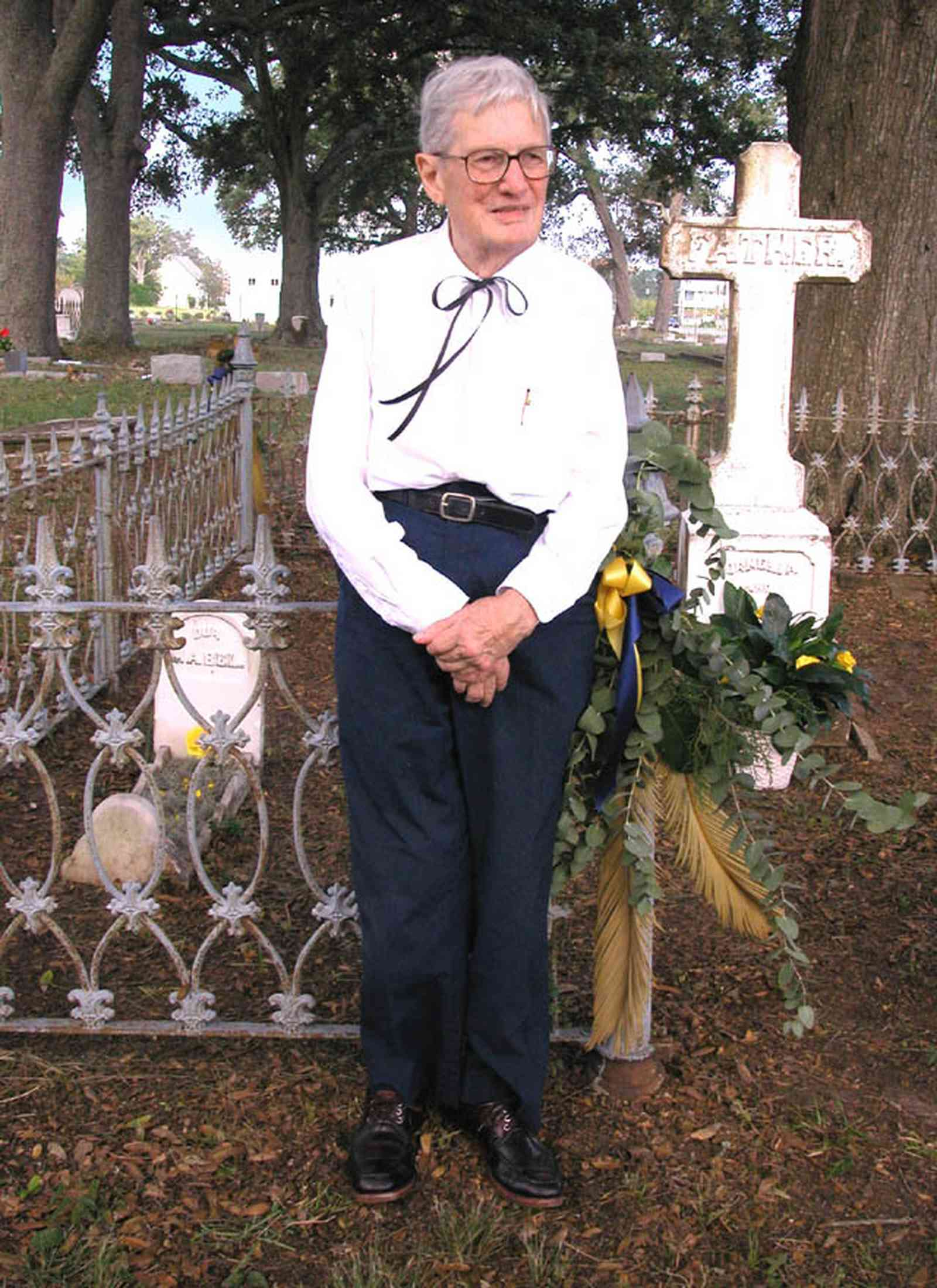 Pensacola:-Seville-Historic-District:-St-Michael-Cemetery_34.jpg:  wrought iron fence, tombstone, grave, oak trees, commemorative marker
