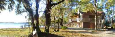 Peterson-Point:-Tree-House_02.jpg:  bay, house, spanish moss, pine tree, deck, boat house