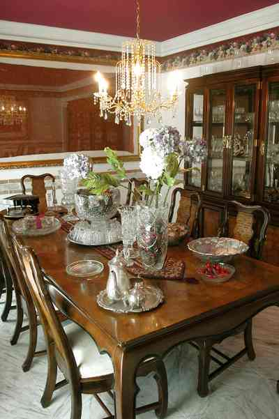 Scenic-Highway:-3780-Scenic-Ridge-Drive_06.jpg:  crystal chandelier, silver tea service, china cabinet, dried flowers, punch bowl, mirrored wall, marble floor