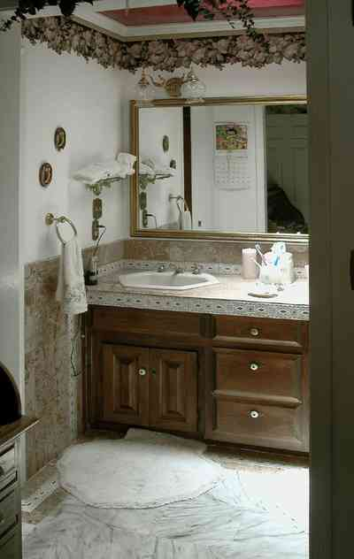 Scenic-Highway:-3780-Scenic-Ridge-Drive_10.jpg:  bathroom, cabinet, marble floor, mirror, floral wallpaper border