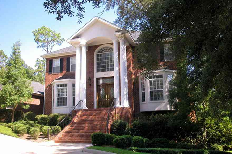 Scenic-Highway:-4220-Montalvo-Street_04.jpg:  colonial architectural style, white columns, shutters, crown molding pediment, circular driveway, carriage lamp, sycamore tree, box hedge,