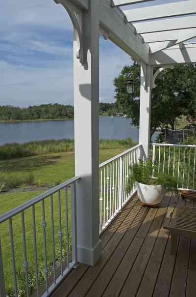 400+LaRua+Landing-2nd+floor++porch+facing+bayou+texar_6.jpg.jpg:  trellis, porch, railing, Bayou Texar, oak tree,