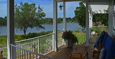 400+LaRua+Landing-2nd+floor+side+porch_03.jpg:  porch, railings, oak tree, Bayou Texar, trellis, deck,