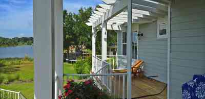400+LaRua+Landing-2nd+floor+side+porch_04.jpg:  trellis, Bayou Texar, Coastal home,