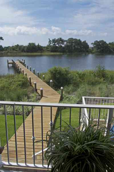 400+LaRua+Landing-3rd+floor+porch+facing+Bayou+Texar_01.jpg:  metal railing, porch island, Bayou Texar, dock, pier, ,
