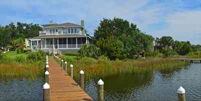 400+LaRua+Landing-rear+facade+facing+Bayou+Texar_03.jpg:  coastal home, pier, sawgrass, needle grass, deck Bayou Texar,