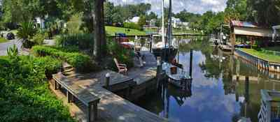409+Montrose+Blvd-front+yard_04.jpg:  lake, flagstone, bench, boat house, oak tree, Gulf Breeze,