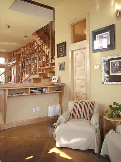 Aragon:-649-Aragon-Street_22.jpg:  open floor plan, transom, wooden cabinets, setting area, wrought-iron bannisters