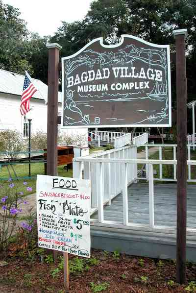 Bagdad:-Church-Museum_02.jpg:  church, museum, sign, bazaar, festival, fish fry, sausage biscuit, american flag,  market day