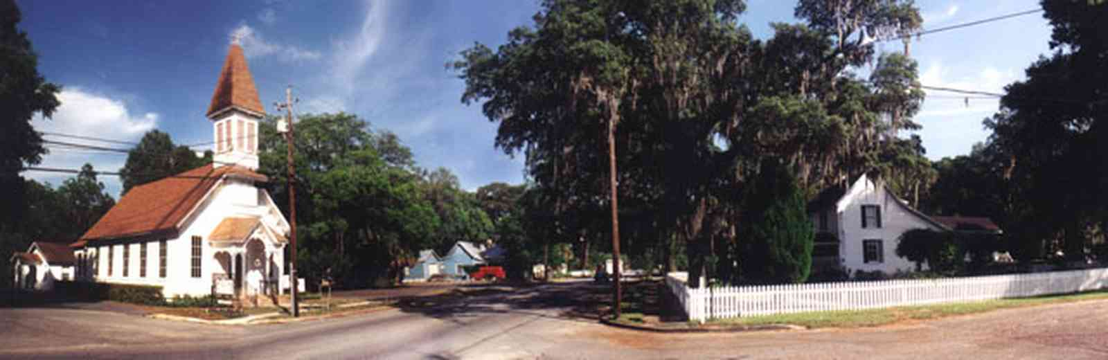 Bagdad:-Methodist-Church_00.jpg:  victorian church building, spanish moss, oak trees, small town, white picket fence ,