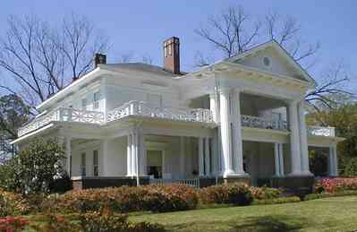 Brewton:-Belleville-Avenue_05.jpg:  victorian mansion, front porch, greek revival facade, classical revival, columns, azalea bushes, turret, colonnade