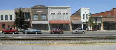 Brewton:-Downtown_00a.jpg:  store front facades, railroad tracks, main street america, 1920\