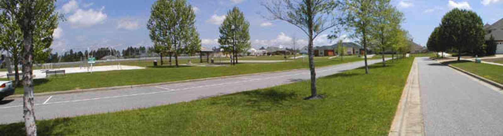 Cantonment:-Milestone_16.jpg:  cumulus clouds, oak trees, boulevard, tract houses, garden