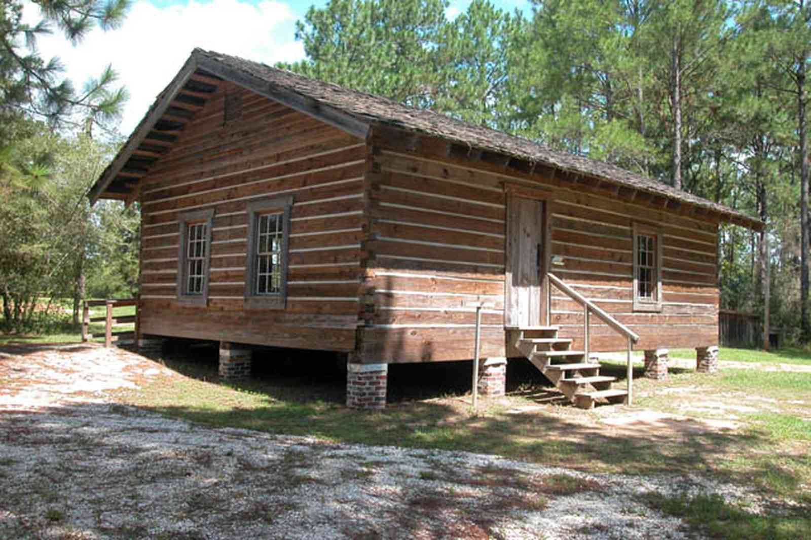 Cantonment:-Roy-Hyatt-Environmental-Center-Schoolhouse_02.jpg:  school, one-room schoolhouse, log cabin, pine trees, shake roof, wooden roof, cabin in the woods, single-pen house