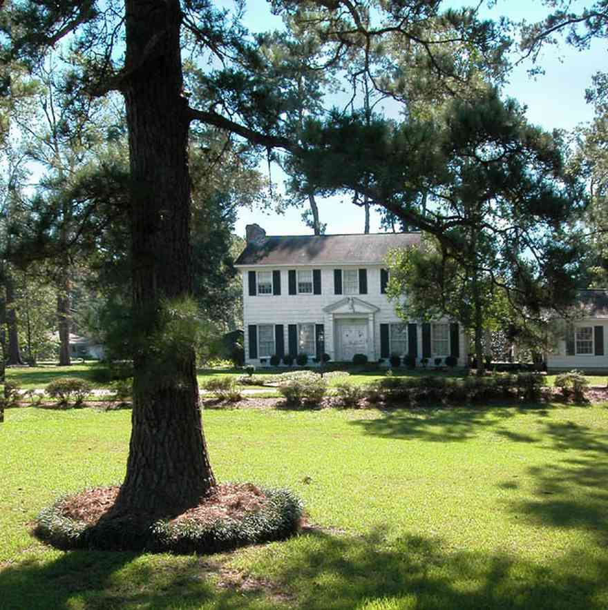 Century:-7542-South-Jefferson-Avenue_01.jpg:  colonial home, pediment, formal doorway, pine tree, azelea bush, country estate
