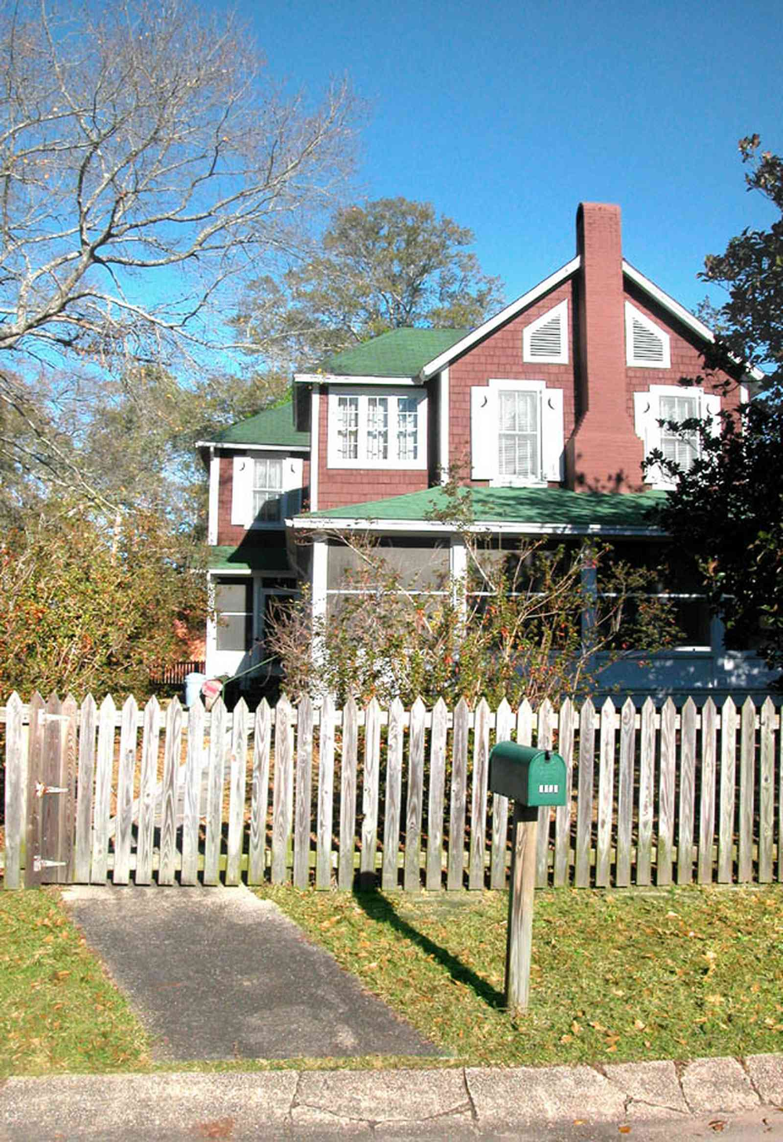 Century:-Historic-District:-Showalter-House_02.jpg:  picket fence, mailbox, sidewalk, gate, green roof, half moon shutters, wood siding, screen porch, pecan tree, historic district, magnolia tree, oak tree, sidewalk